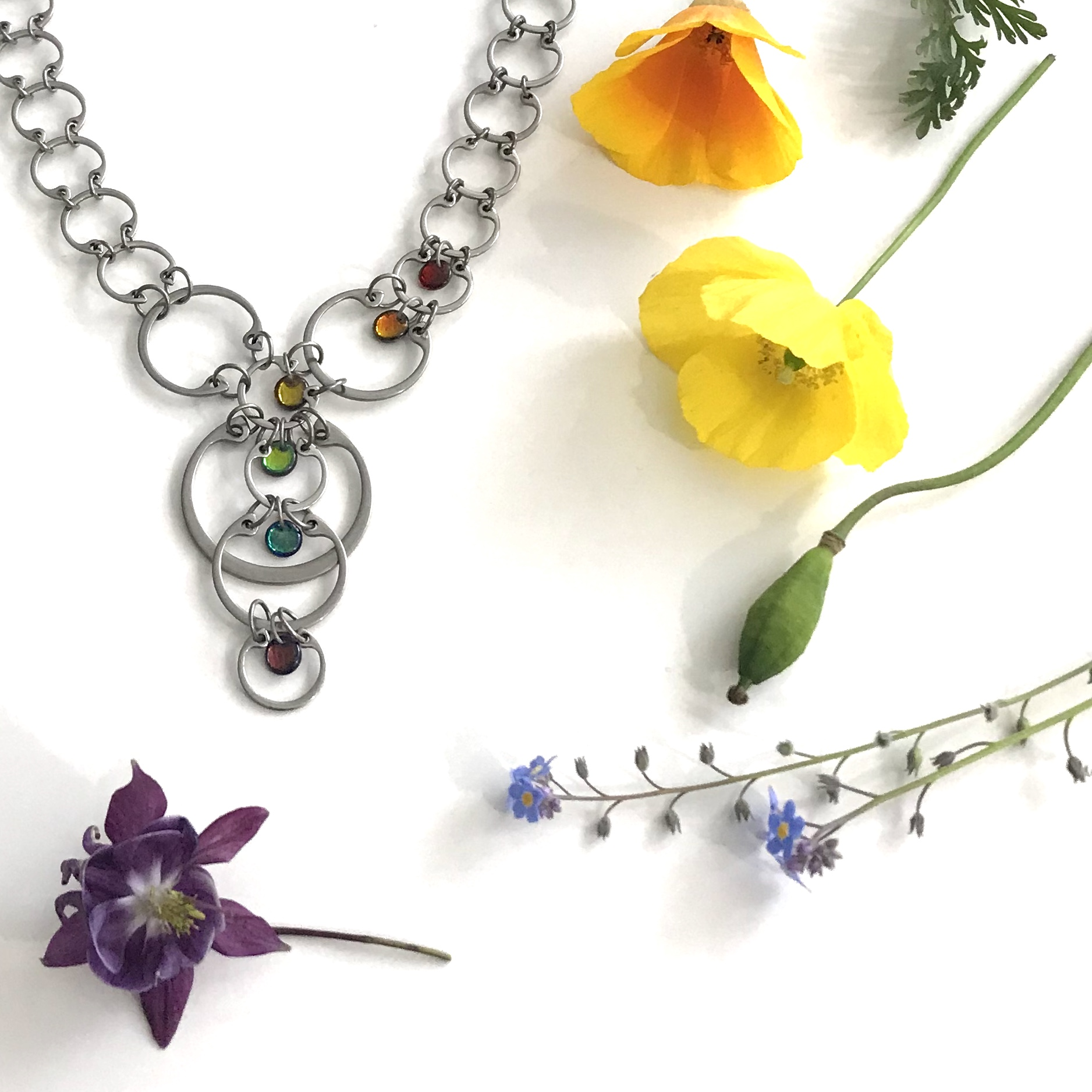 Cascading Rainbows Necklace with a rainbow of flowers