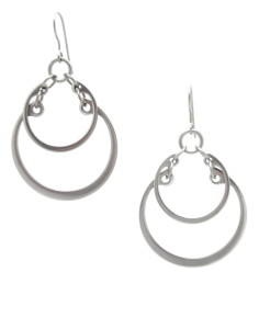 Photo of the Overlapping Graduated Earrings by Wraptillion (modern geometric overlapping circles earrings in silver tone.)
