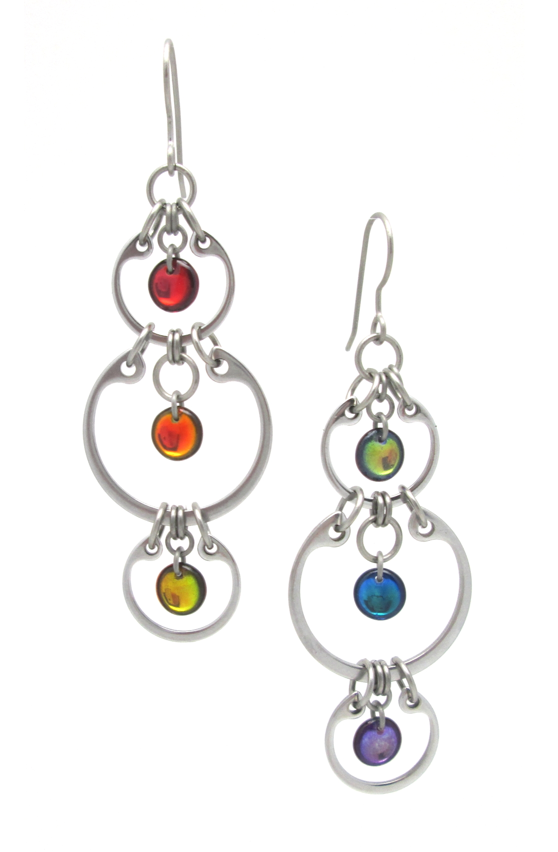 A photo of Wraptillion's sleek, modern, colorful Alternating Rainbow Earrings (linked stainless circle dangle earrings) on a white background.