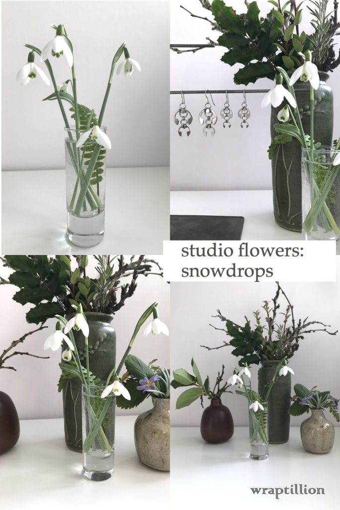 """a collage of 4 photos, featuring cut snowdrops in a small glass vase with a fern frond, shown in front of other small winter leaf, branch, and flower arrangements and Wraptillion's Hops Earrings and Short Fuchsia Earrings. Text on image reads """"studio flowers: snowdrops"""" and """"wraptillion."""""""