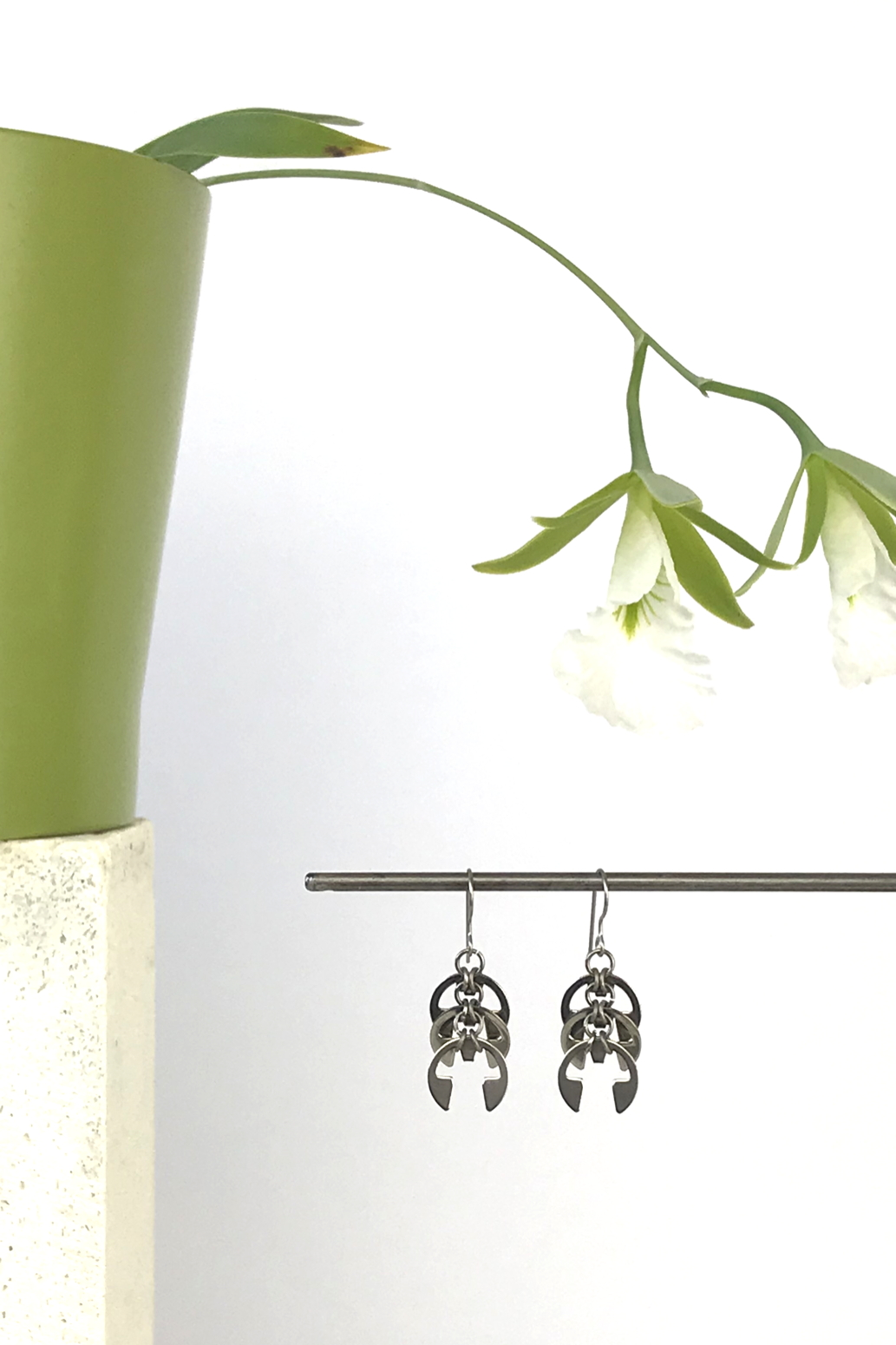 Wraptillion's Fir Cones Earrings with blooming orchid Encyclia mariae.