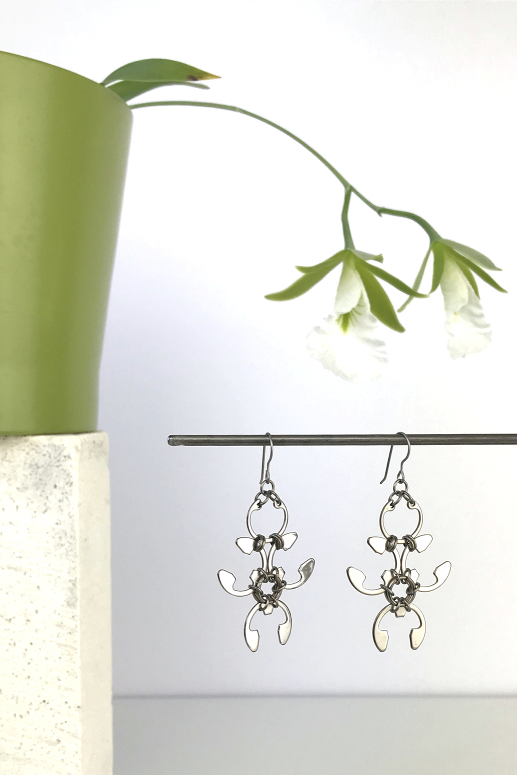Wraptillion's Garland Earrings with blooming orchid Encyclia mariae.