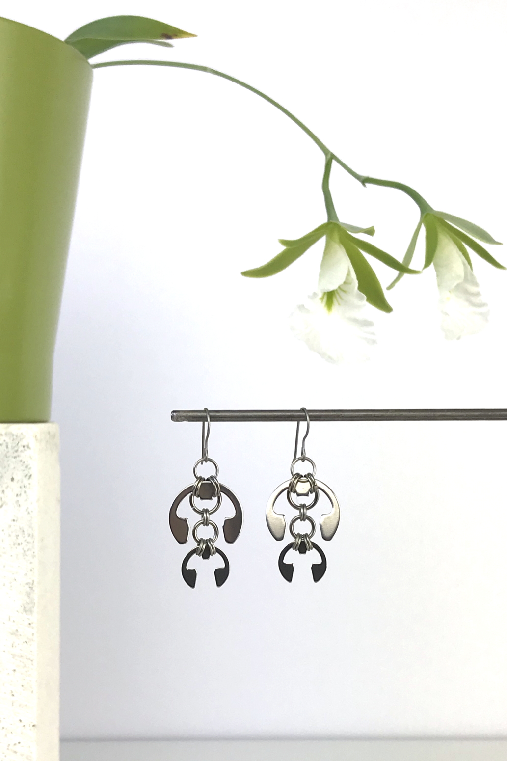 Wraptillion's Hops Earrings with blooming orchid Encyclia mariae.