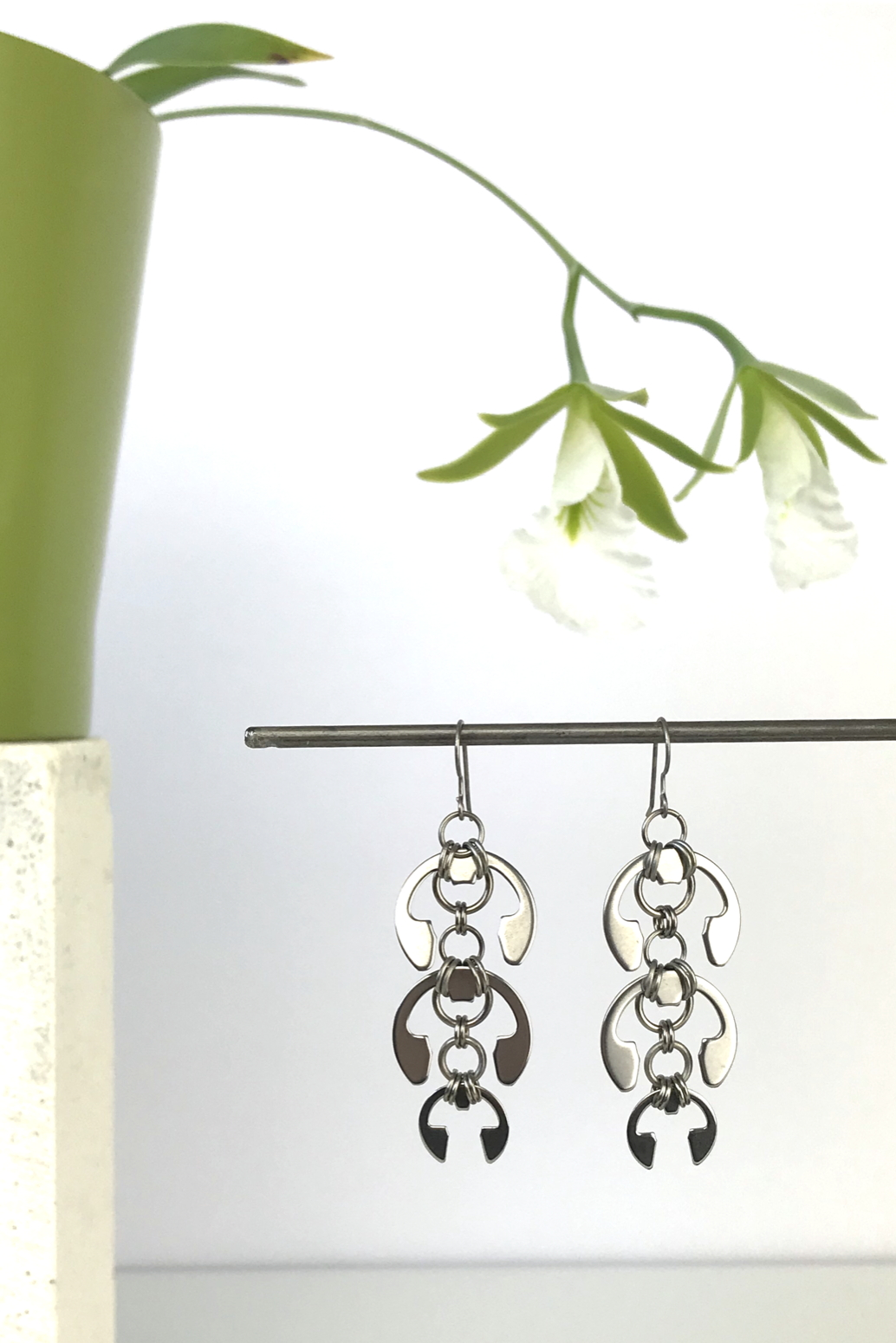 Wraptillion's Laburnum Earrings with blooming orchid Encyclia mariae.