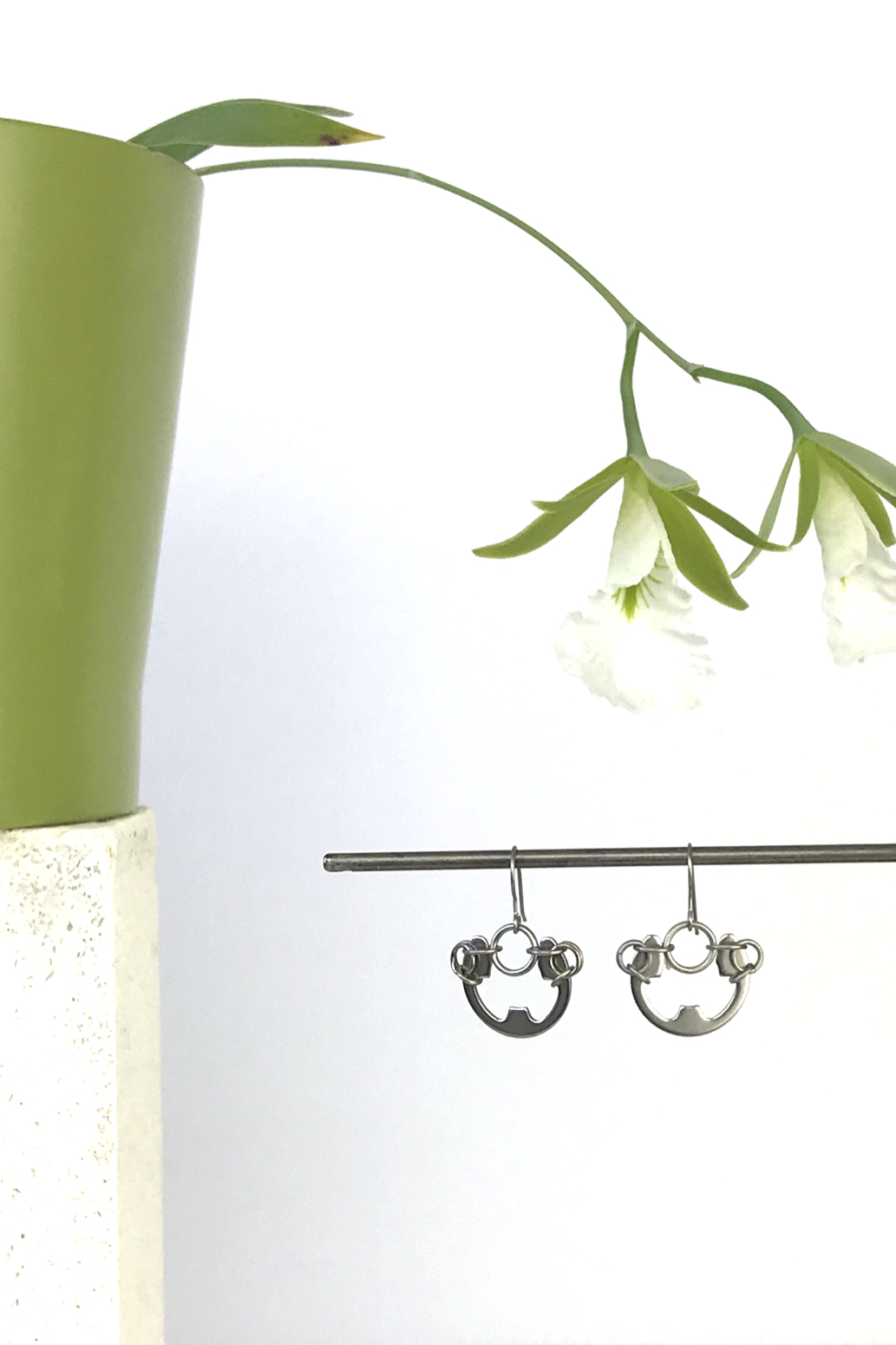 Wraptillion's Large Poppy Earrings with blooming orchid Encyclia mariae.