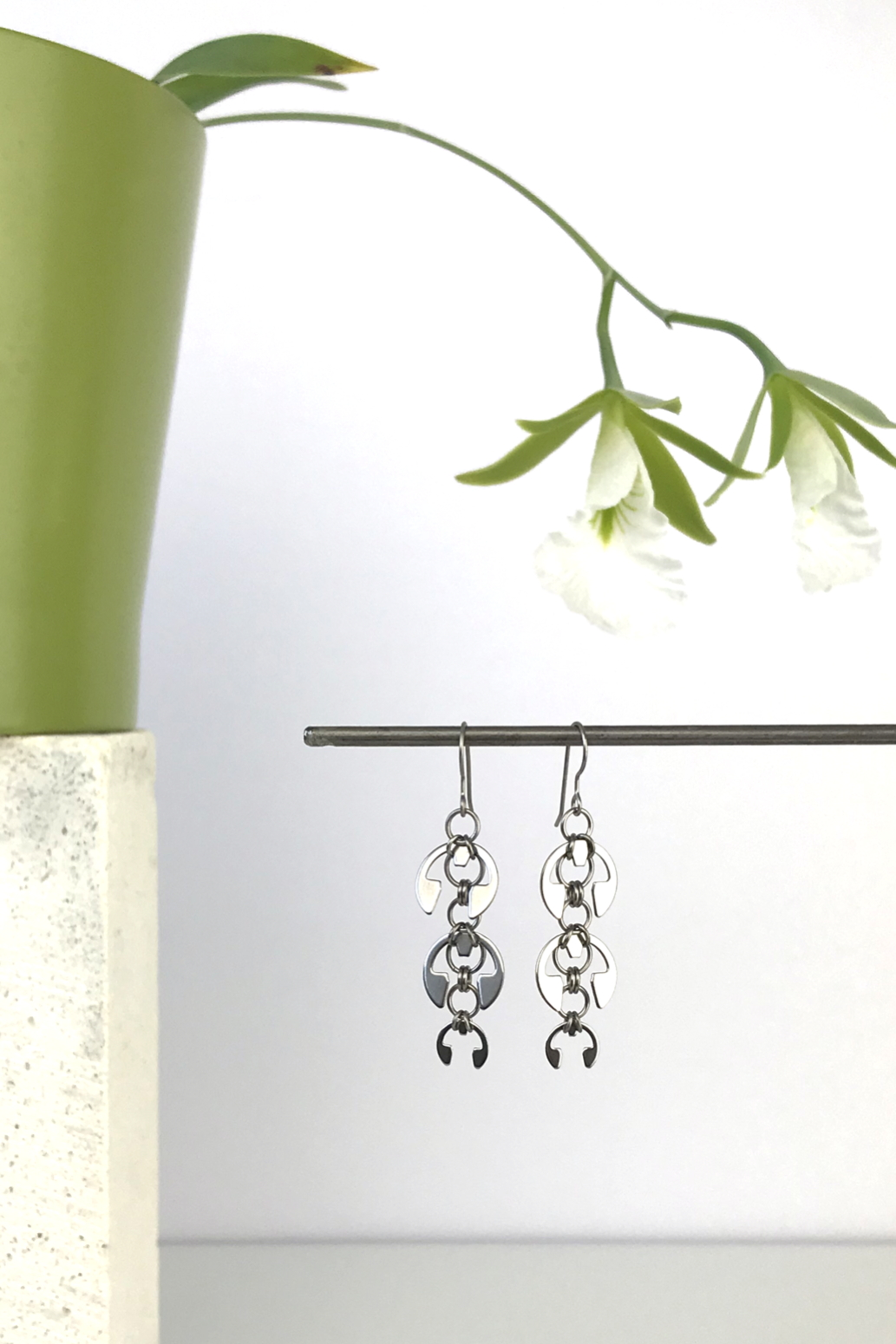 Wraptillion's Long Fuchsia Earrings with blooming orchid Encyclia mariae.