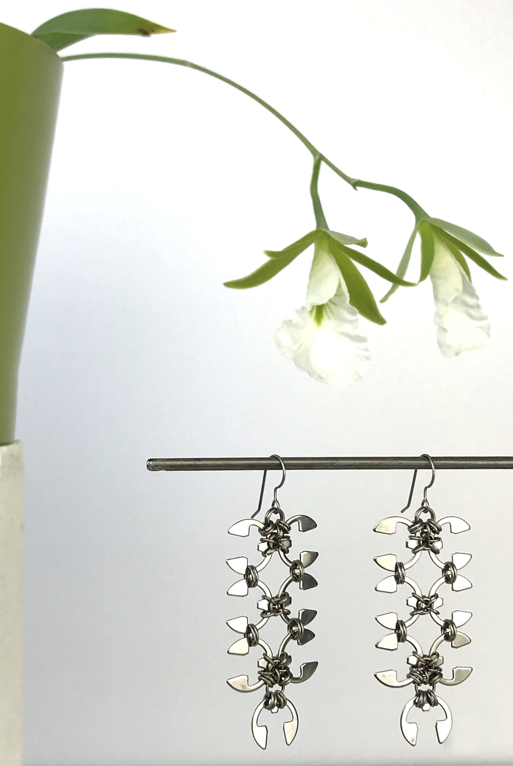 Wraptillion's Long Wisteria Earrings with blooming orchid Encyclia mariae.