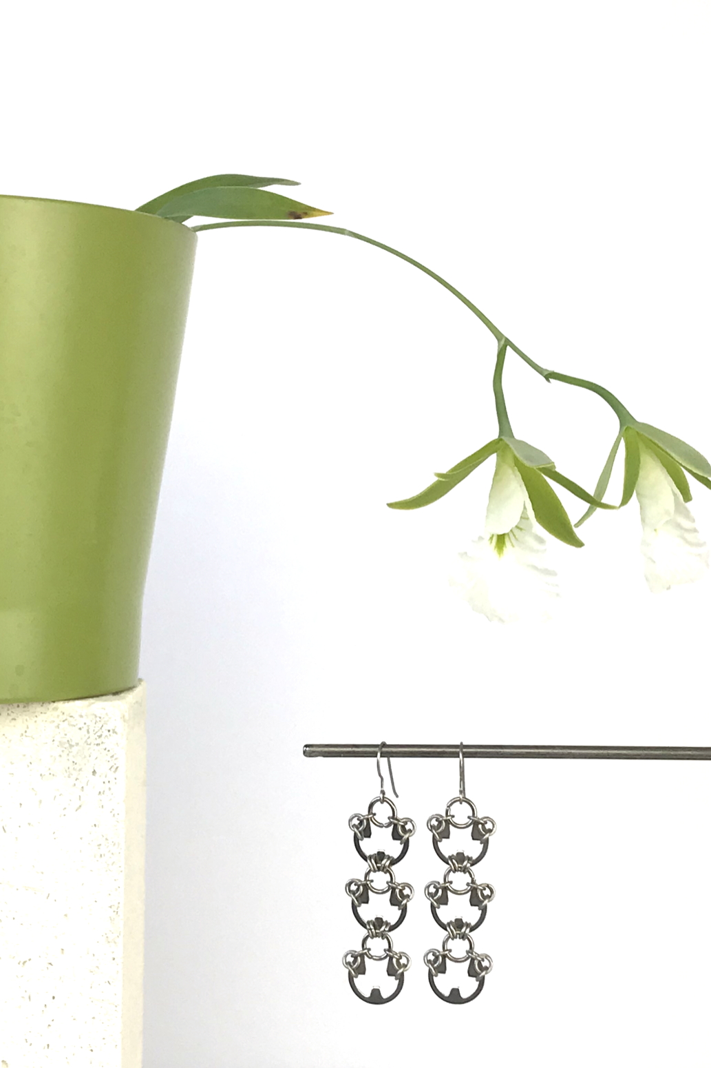 Wraptillion's Lotus Earrings with blooming orchid Encyclia mariae.