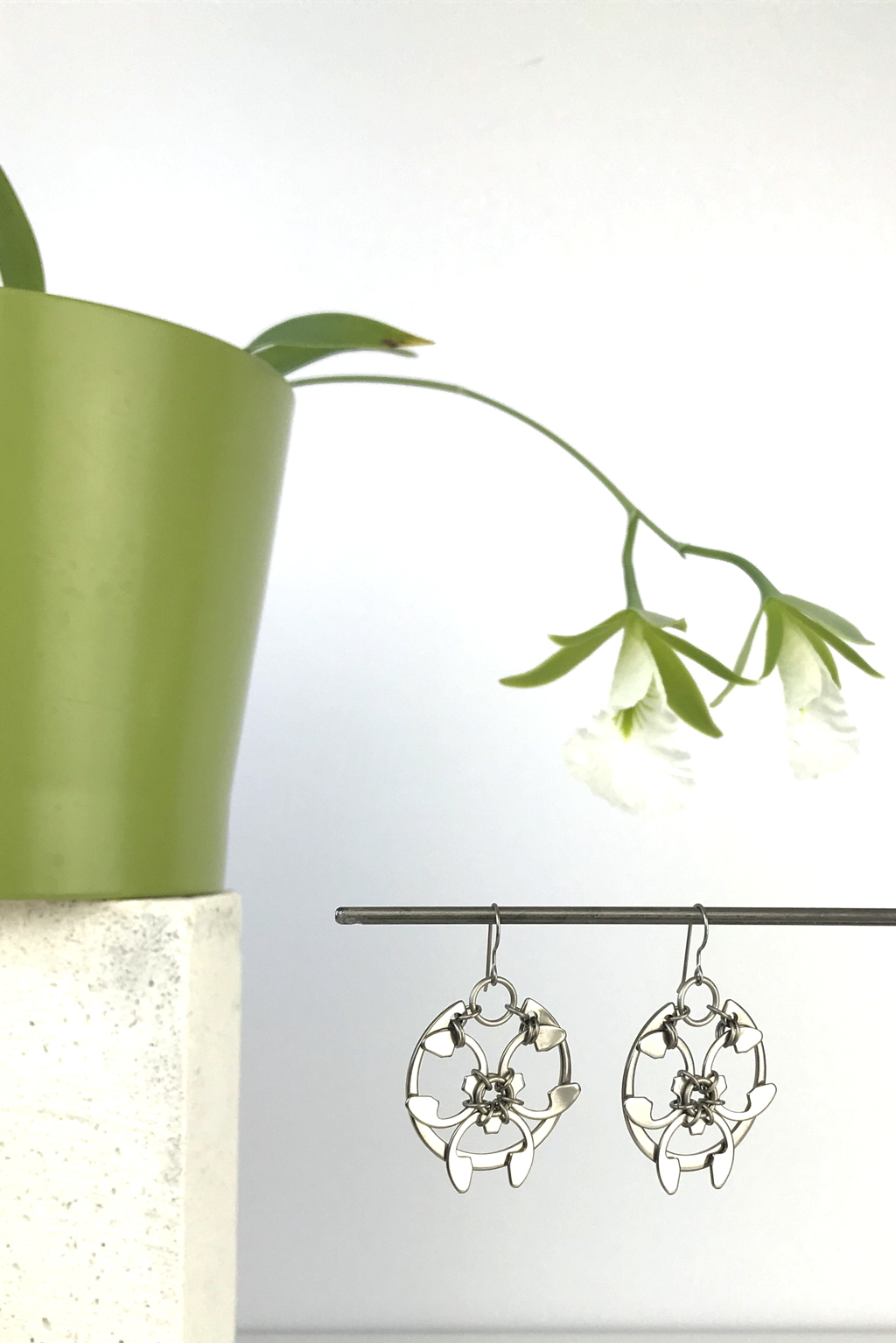 Wraptillion's Rose Window Earrings with blooming orchid Encyclia mariae.
