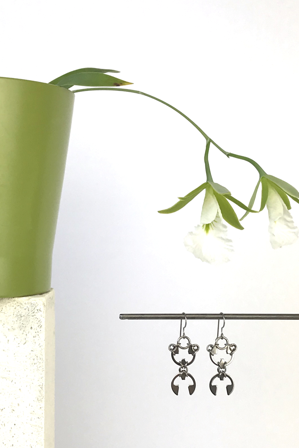 Wraptillion's Scarab Earrings with blooming orchid Encyclia mariae.