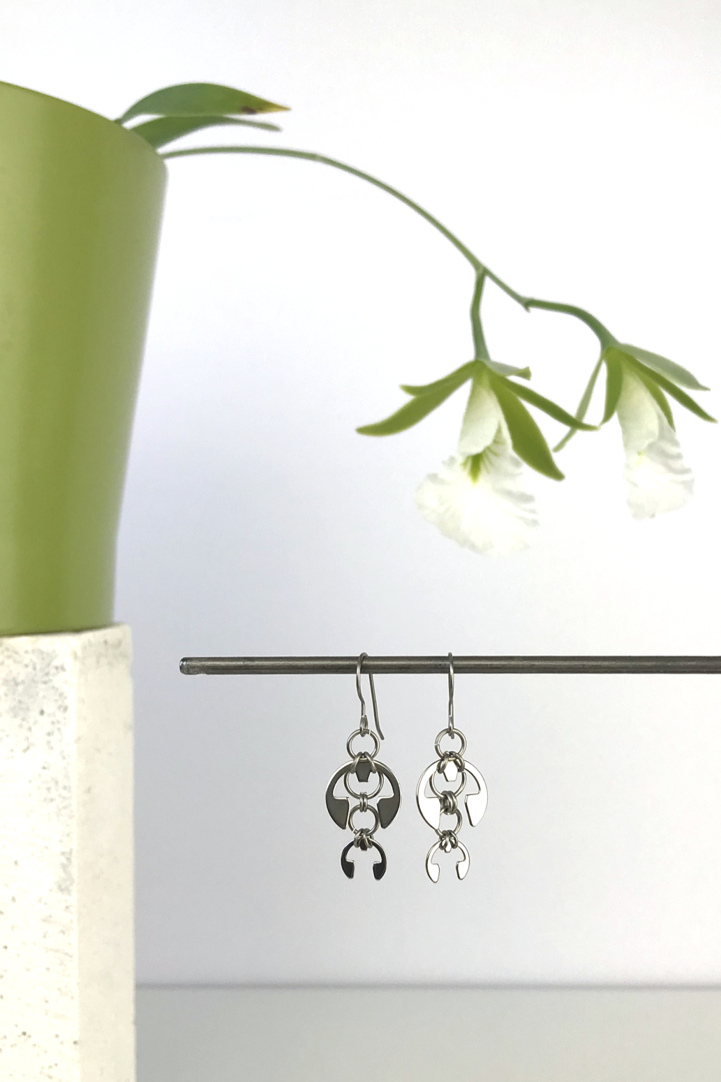 Wraptillion's Short Fuchsia Earrings with blooming orchid Encyclia mariae.