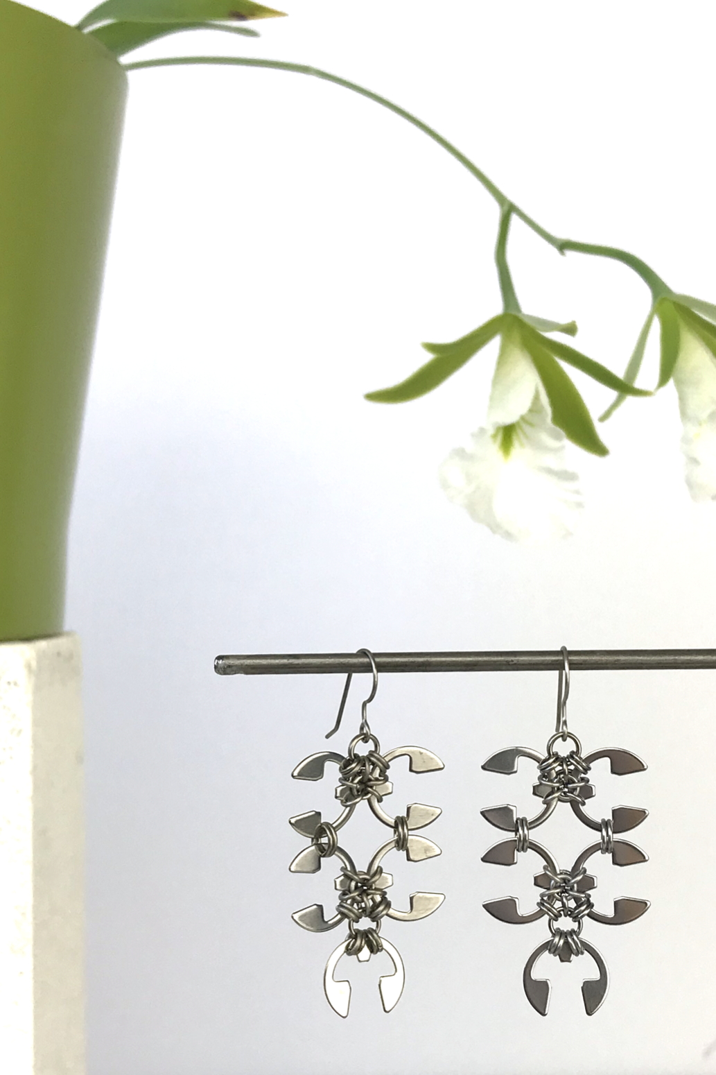 Wraptillion's Short Wisteria Earrings with blooming orchid Encyclia mariae.