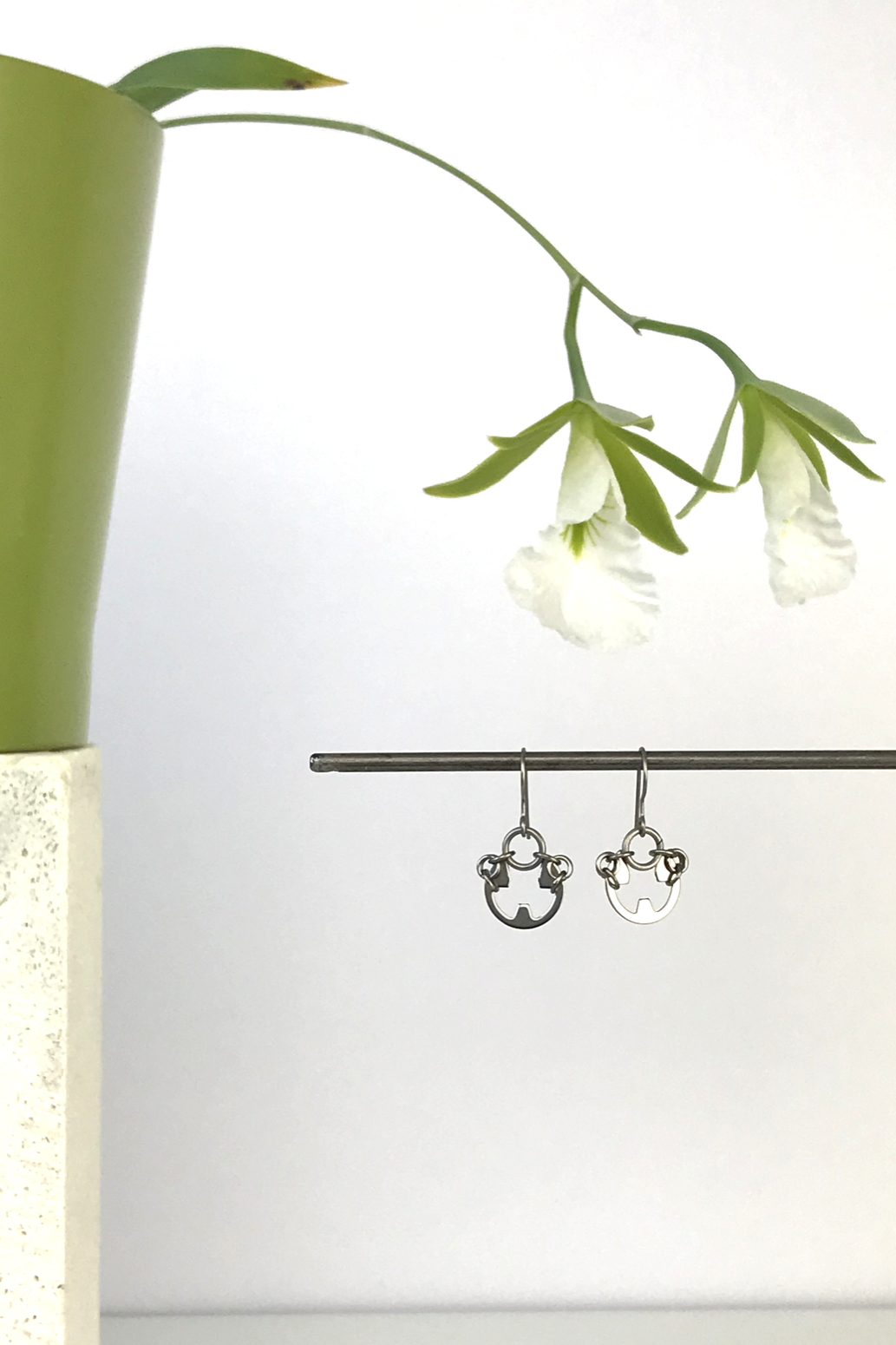 Wraptillion's Small Poppy Earrings with blooming orchid Encyclia mariae.