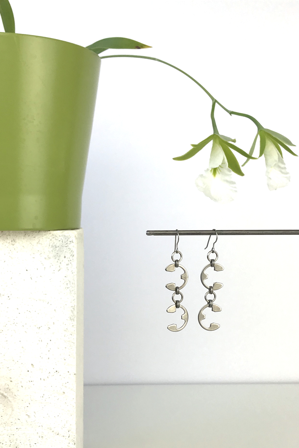 Wraptillion's Tendril Earrings with blooming orchid Encyclia mariae.