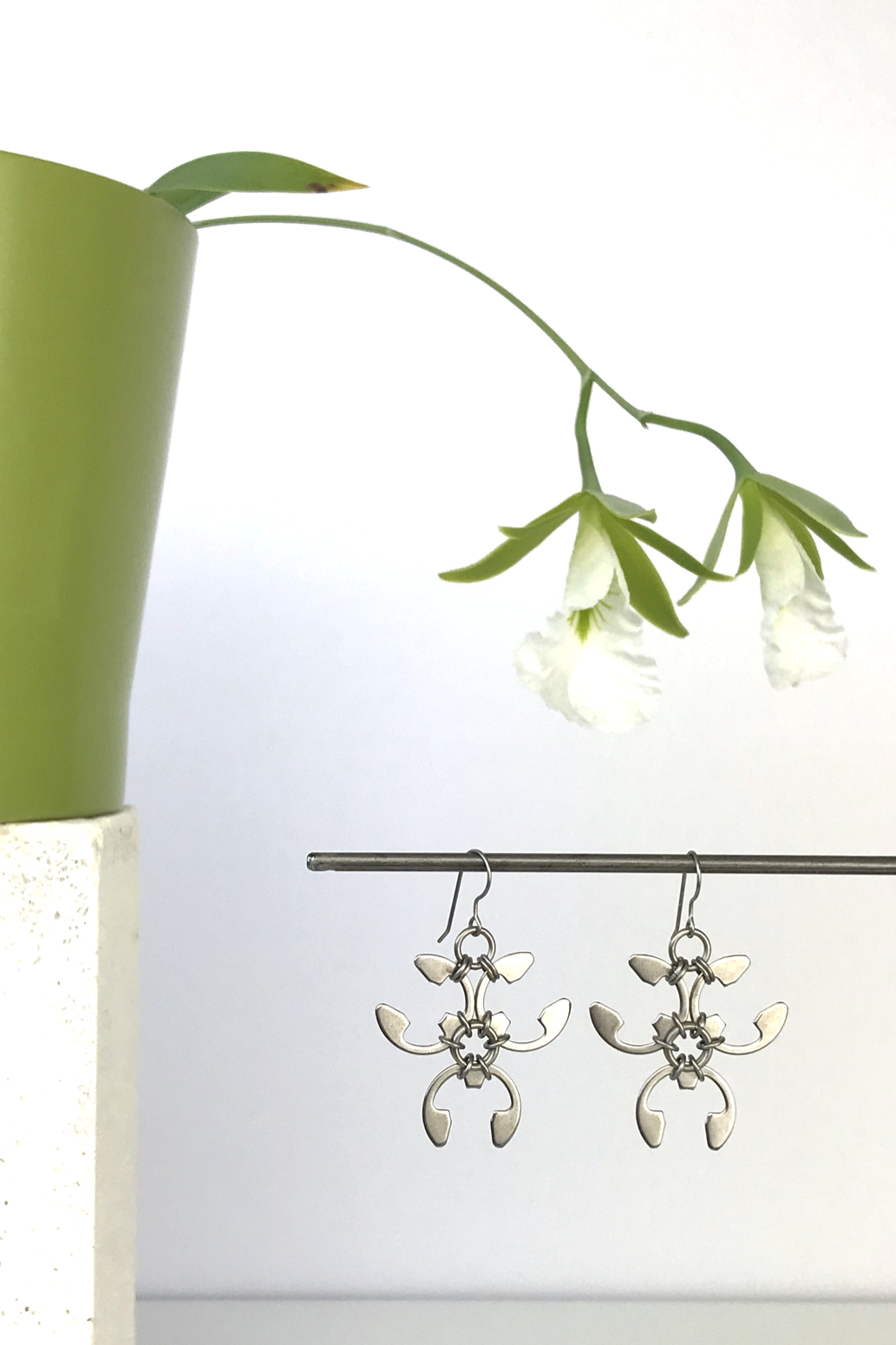 Wraptillion's Trellis Earrings with blooming orchid Encyclia mariae.