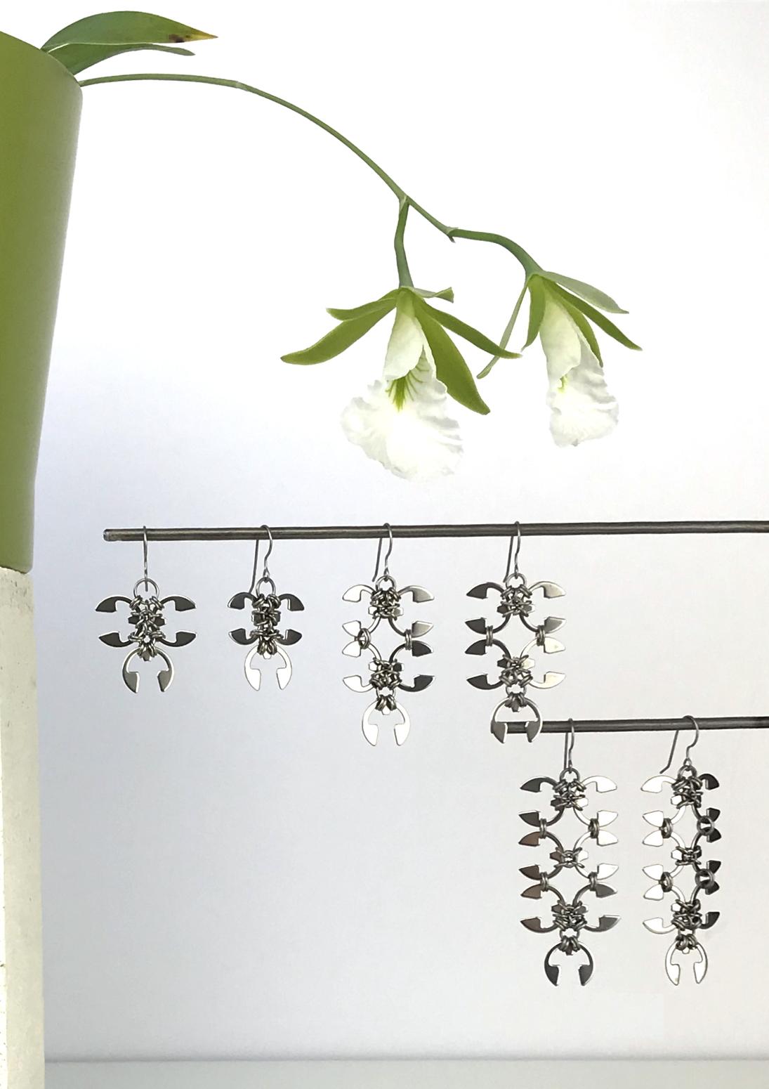 Wraptillion's Ivy Earrings, Short Wisteria Earrings, and Long Wisteria Earrings with blooming orchid Encyclia mariae.